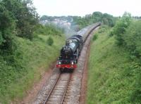 <I>The Torbay Express</I>, comprising eleven coaches steam hauled from Bristol by 6024 <I>King Edward I</I>, is on the last leg of its journey to Kingswear as it leaves Churston and begins the descent to the Dart Estuary.<br><br>[Mark Bartlett&nbsp;13/06/2010]