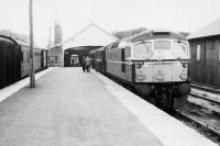 A train for Inverness waits to leave Thurso behind a BRCW Type 2 in July 1963.<br> <br><br>[Colin Miller&nbsp;/07/1963]