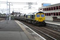 Freightliner 66 598 accelerates through Paisley Gilmour Street on the Down Ayr line on 14 June after biding its time in Arkleston loop.<br><br>[David Panton&nbsp;14/06/2010]