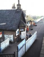 The station building on the westbound platform at Shotts, photographed from the footbridge in October 1985.� The building is almost identical to the one at West Calder [see image 15556], the only apparent difference being the shape of the dormer.� Note the British Railways era enamel run-in board, a rare survivor 21 years after the image change.�It had not worn well.� Twenty-five years on from that, in 2010, the ticket office is still open; it's the only one on the 14 stations exclusive to this line. <br> <br><br>[David Panton&nbsp;/10/1985]