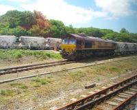 Grab shot of a China Clay train from the Rocks complex, taken from a passing Newquay branch train that it followed when the single line to Par cleared. 66093 was taking the loaded clay wagons to the port at Fowey via reversal at Lostwithiel. <br><br>[Mark Bartlett&nbsp;15/06/2010]