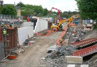 A hive of activity at Caldercruix on 14 June 2010. View is east over the new station works towards the site of the old Main Street road bridge.<br><br>[John Furnevel&nbsp;14/06/2010]