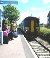 The 1045 National Express East Anglia service from Norwich arrives at the BRB 1967 Sheringham terminus in bright sunshine on 15 June 2010. The previously severed level crossing behind the camera beyond which stands the original station, now operated by the North Norfolk Railway, was recently reconnected after 46 years. [See image 28075]<br><br>[Bruce McCartney&nbsp;15/06/2010]