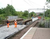 End of the line. The line to Drumgelloch shown terminated at buffer stops just beyond Broomknoll Street bridge, east of Airdrie station, on 14 June 2010. Work on the double track Airdrie - Bathgate link continues in the background. [See image 9670]<br><br>[John Furnevel&nbsp;14/06/2010]