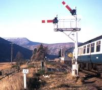 A Class 40-hauled train pulls into the loop at Dalnaspidal in November 1976, just months before semaphore signalling and the local box disappeared in the Blair Atholl-Dalwhinnie redoubling scheme. The dramatic backdrop is formed (from left to right) by The Sow of Atholl, A' Mharconaich and the Boar of Badenoch.<br><br>[Frank Spaven Collection (Courtesy David Spaven)&nbsp;/11/1976]