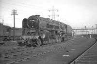 BR Standard class 9F no 92066, one of the batch of powerful 2-10-0s allocated to Tyne Dock shed specifically to handle the gruelling Tyne Dock - Consett iron ore trains. The locomotive is seen on its home shed in March 1961 displaying a 52H shed plate. All 10 of the Tyne Dock 9Fs were fitted with Westinghouse pumps (on the other side of the locomotive) required to operate the pneumatic discharge doors on the iron ore hoppers. [See image 24029]<br><br>[K A Gray&nbsp;26/03/1961]