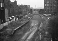 Remains of Merchiston station in 1972 looking east towards Dalry Junction. The trackbed now provides vehicle access to Slateford Yard behind the camera. [See image 11416]<br><br>[Bill Jamieson&nbsp;//1972]