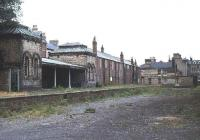 View east at a run down Saltburn in the late 1970s showing the north side of the former station. In the far right background stands the Zetland Hotel, built by the Stockton & Darlington Railway in 1863 and once served by its own private platform. [See image 29466] <br><br>[Ian Dinmore&nbsp;//]