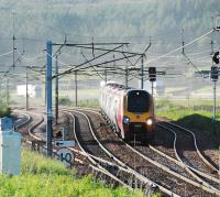 A southbound Voyager passes the empty loops at Beattock Summit. The (seemingly unending supply of) trucks are on the M74 in the background.<br><br>[Ewan Crawford 14/06/2010]