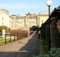 The old private platform of the Zetland Hotel, Saltburn, now incorporated into the landscaped and redeveloped area that once formed part of the station. View east from the end of the main public platform [see image 17867] in 2008 showing the canopy over the rear entrance to the hotel once used by guests arriving or departing by train.<br> <br><br>[John Furnevel&nbsp;03/04/2008]