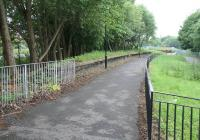 View west from the surviving platform of Dalry Road station on 6 June 2010. Part of the Western Approach Road, which now occupies the former route of the Caledonian main line from Princes Street station, is visible through the trees on the left. The line north is starting to curve away here before crossing Dalry Road itself to reach Dalry Middle Junction [see image 35358].  <br><br>[John Furnevel&nbsp;06/06/2010]