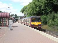 The driver of 320 318 has just switched from tail to driving lights in readiness to depart Balloch for Airdrie on 14 June.� Twelve years on from a visit in 1998 [see image 21990] and little has changed apart from the livery of the 320. <br> <br><br>[David Panton&nbsp;14/06/2010]