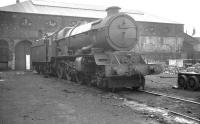 <I>King Henry VII</I> stands in the yard of the former Stafford Road works in Wolverhampton, on 15 August 1962. The locomotive, which had been withdrawn from nearby 84A Stafford Road shed in September of that year, was cut up in a local scrapyard the following March.<br><br>[K A Gray&nbsp;15/08/1962]