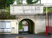 Passenger exit on the north side of Craigendoran station on 8 June 2010, looking across the line from the south (out of use) platform. Beyond the subway running below the West Highland line stand the houses of Dennistoun Crescent.<br><br>[John Furnevel&nbsp;08/06/2010]