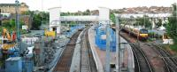 Development continues at Airdrie with the eastbound sleepers now in place and footbridge more complete.<br><br>[Ewan Crawford&nbsp;27/06/2010]