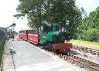 Arrival at Woody Bay on the Lynton & Barnstaple Railway on 27 June 2010, hauled by Kerr Stuart 0-6-0T <I>Axe</I>.<br><br>[Peter Todd&nbsp;27/06/2010]