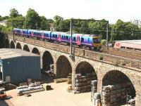The 1208 TransPennine Express service from Edinburgh to Manchester Airport crosses Slateford Viaduct westbound on 3 June 2010. The train's next stop will be at Lockerbie.<br><br>[John Furnevel&nbsp;03/06/2010]