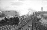 <I>Taking a run at it...</I> Shunning all thoughts of assistance, Britannia Pacific no 70016 <I>Ariel</I> storms north through Beattock station in the mid sixties heading for <I>the bank</I>. 70016 arrived at Kingmoor in 1965 and spent its final two years there, being withdrawn by BR at the end of August 1967.  <br><br>[Robin Barbour collection (Courtesy Bruce McCartney)&nbsp;//]