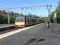 320 315 arrives at Dumbarton Central on 19 June with a Balloch to Airdrie service.<br><br>[David Panton&nbsp;19/06/2010]