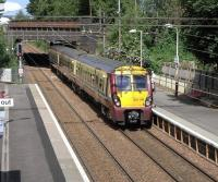 334 016 with a Dalmuir to Springburn service at Scotstounhill station on 19 June 2010.<br><br>[David Panton&nbsp;19/06/2010]
