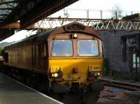 A ballast train heading north through Perth station on 26 June behind locomotive 66114.<br><br>[Brian Forbes&nbsp;26/06/2010]