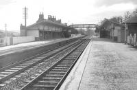 Sixties view along the down platform at Melrose. Note the cast iron 'facilities' on the right, which were subsequently obtained by the Severn Valley Railway where they are in use at Bewdley station. [See image 13842]<br><br>[Robin Barbour Collection (Courtesy Bruce McCartney) //]