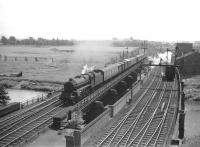 Black 5 no 44850 crosses the River Eden at Etterby in the summer of 1959 with a northbound parcels on the WCML. Meantime a light engine is held at signals on the 1942 bridge built to carry the goods lines, presumably on its way to Kingmoor shed.  <br><br>[Robin Barbour Collection (Courtesy Bruce McCartney)&nbsp;04/07/1959]
