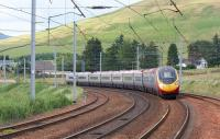 The 1740 hrs Glasgow Central to London Euston Pendolino service leans into the curve as it passes the Abington loops on 3 July 2010. <br> <br><br>[John McIntyre&nbsp;03/07/2010]