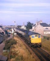 A northbound train powers away from Clachnaharry swing bridge shortly after leaving Inverness in the early 1970s.<br><br>[David Spaven&nbsp;//]
