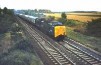 An unidentified <I>Deltic</I> takes an up train past the site of Aberlady Junction on the ECML in 1978. The trackbed of the former Gullane branch can be seen on the right. <br><br>[Bruce McCartney&nbsp;//1978]
