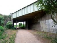 View from the trackbed of the former Haddington branch, taken from the outskirts of Haddington looking west on 26 June.� The overbridge carries the former A1.� Those extra supports can't be original.� All but the last few hundred yards of the branch were converted many years ago to a walkway which, in the absence of obstructions, faithfully follows the trackbed from the branch platform face at Longniddry.� The only exception is for the current A1 dual carriagway where a slight diversion is needed because of the skew. <br> <br><br>[David Panton&nbsp;26/06/2010]