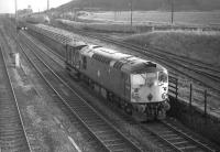 Class 26 no D5325 approaches Niddrie West Junction from Millerhill Yard in February 1970 with only a brake van in tow on what is probably an afternoon trip working within the Edinburgh area.<br> <br><br>[Bill Jamieson&nbsp;04/02/1970]