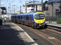 First TransPennine 185 506 pulls into Haymarket on 15 June with the early morning Manchester Airport - Edinburgh Waverley service.<br><br>[David Panton&nbsp;15/06/2010]