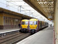 Class 334s coming from (left) and heading for Gourock meet at Paisley Gilmour Street on 14 June 2010.<br><br>[David Panton&nbsp;14/06/2010]