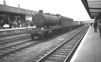 Class O4 2-8-0 no 63802, displaying a local 36A shedplate, takes a lengthy freight south on the centre road through Doncaster station on 28 July 1962.<br><br>[K A Gray&nbsp;28/07/1962]
