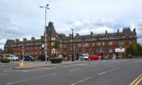 The impressive red sandstone frontage of Ayr station and The Station <br> Hotel viewed looking east across Smith Street on 3 July 2010.<br> <br><br>[John McIntyre&nbsp;03/07/2010]