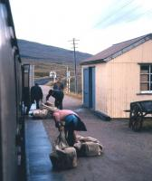 Still a multi-purpose train to Kyle in the summer of 1974 - parcels and mail being offloaded from the mid-morning train ex-Inverness at Achnasheen.<br><br>[David Spaven&nbsp;//1974]
