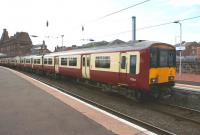 318254 and a second set wait in platform 1 at Ayr on 3 July 2010 <br> with a service for Glasgow Central.<br> <br><br>[John McIntyre&nbsp;03/07/2010]