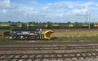 Freightliner Class 66 locomotives awaiting their next duties at Kingmoor on 3 July 2010. In the foreground is a snowplough which looks very much like a modified bogie from a Class 40, 44, 45 or 46 without the leading axle.<br> <br><br>[John McIntyre&nbsp;03/07/2010]