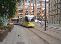 The <I>new order</I> on Manchester's Metrolink as Tram 3006 climbs to Piccadilly Gardens on a Piccadilly station to Eccles service. The stations are steadily being improved and rebranded in this new corporate scheme of yellow and grey but the earlier 10xx and 20xx series trams are all still in the original turquoise, white and grey livery. <br><br>[Mark Bartlett&nbsp;09/07/2010]