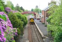 A southbound train pulls away from a colourful Maybole station and heads for Girvan on the last day of May 2007.<br><br>[John Furnevel&nbsp;31/05/2007]