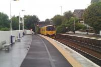 View south at Inverkeithing station on 10 July 2010 showing a Network Rail inspection unit standing at the platform.  The unit has just arrived 'wrong line' from Inverkeithing South Junction after coming off the Rosyth Dockyard branch. The tail lights have just been switched on and a member of the crew is about to return the token to the padlocked box on the fence by the signal before heading off on the main line towards Edinburgh.<br><br>[Grant Robertson&nbsp;10/07/2010]