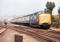 Deltic no 9009 <I>Alycidon</I> speeds past Ouston Junction on 20 August 1971 with the 13.05 Newcastle Central - Kings Cross service. The line to the left is turning west towards South Pelaw Junction where it will join the route to Consett.<br><br>[Bill Jamieson&nbsp;20/08/1971]