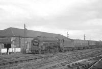 Jubilee 4-6-0 no 45736 <I>Phoenix</I> passing Crown Street goods depot on the southern approach to Carlisle in the 1960s with the 3.40pm ex-Bradford. No 45736 was one of the pair of specially rebuilt versions of the class, along with 45735 <I>Comet</I> [see image 23555]. This particular example was withdrawn from Kingmoor in September 1964 and cut up at Hughes Bolckows, North Blyth, the following January. <br><br>[K A Gray&nbsp;11/07/1964]