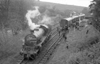 The SLS <I>Three Dales Railtour</I> stands at Westgate-in-Weardale on 20 May 1967. K1 2-6-0 no 62005 is in the process of running round the train, prior to taking the special on to journey's end at Middlesbrough.  <br><br>[Robin Barbour Collection (Courtesy Bruce McCartney)&nbsp;20/05/1967]