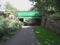 Course of the CR's Leith New Line (1903 to 1968) as it passed under <br> Ferry Road, looking north on 12 July 2010.�For a view the other way in 1963 [see image 28071]. �The former cutting from Newhaven Junction to the old Chancelot Mill has been substantially filled in, but there's a dip here to allow the walkway to go under Ferry Road.� Platforms were built here (as elsewhere on the line) for a station which never opened, the line remaining goods only.� If you can see a council van coming towards me, it's more than I did. <br> <br><br>[David Panton&nbsp;12/07/2010]