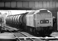 <I>'Oil be seeing you...' </I> crew change for a class 47 with a tank train at the south end of Rotherham Masborough station in May 1981. In the background an EE Type 4 waits for a path with another northbound freight. <br><br>[John Furnevel&nbsp;04/05/1981]