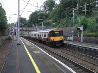 The tendency for Scottish placenames to sound more romantic than than the actuality, and the tendency for rail locations to look more leafy than their immediate surroundings come together at Cambuslang, where 318 262 is seen calling with a Dalmuir service on 14 July. <br> <br><br>[David Panton&nbsp;14/07/2010]