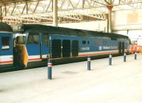 50030 Repulse at the buffer stops following arrival at Waterloo Station on a Network South East service from Exeter late on a Sunday afternoon in March 1991. <br><br>[David Pesterfield&nbsp;03/03/1991]
