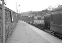 A Sulzer Type 2 coming onto the Inverness train at Kyle of Lochalsh in July 1963<br><br>[Colin Miller&nbsp;/07/1963]